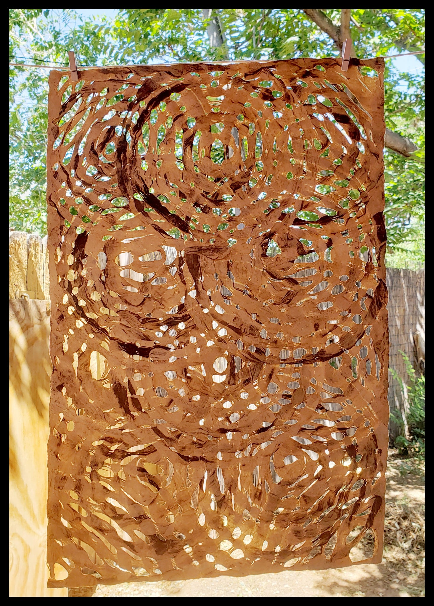 "Amate handmade paper created in Mexico from wild fig trees Bark colored circles approximately 16' x 20"" patterns vary ADA the gilded page Santa Fe"