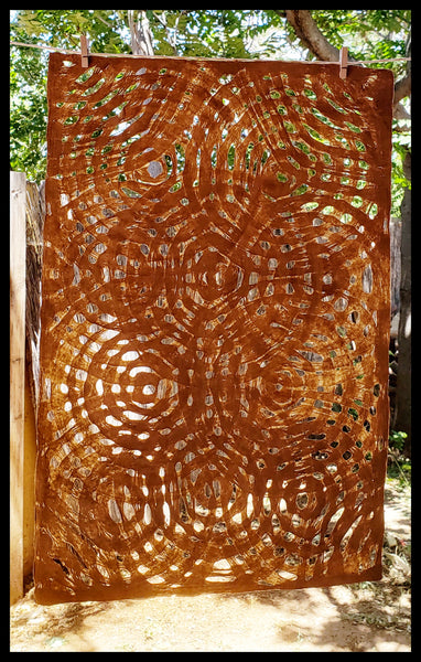 "Amate handmade paper created in Mexico from wild fig trees approximately 16"" x 20"" circle pattern medium brown color ADA the gilded page Santa Fe"