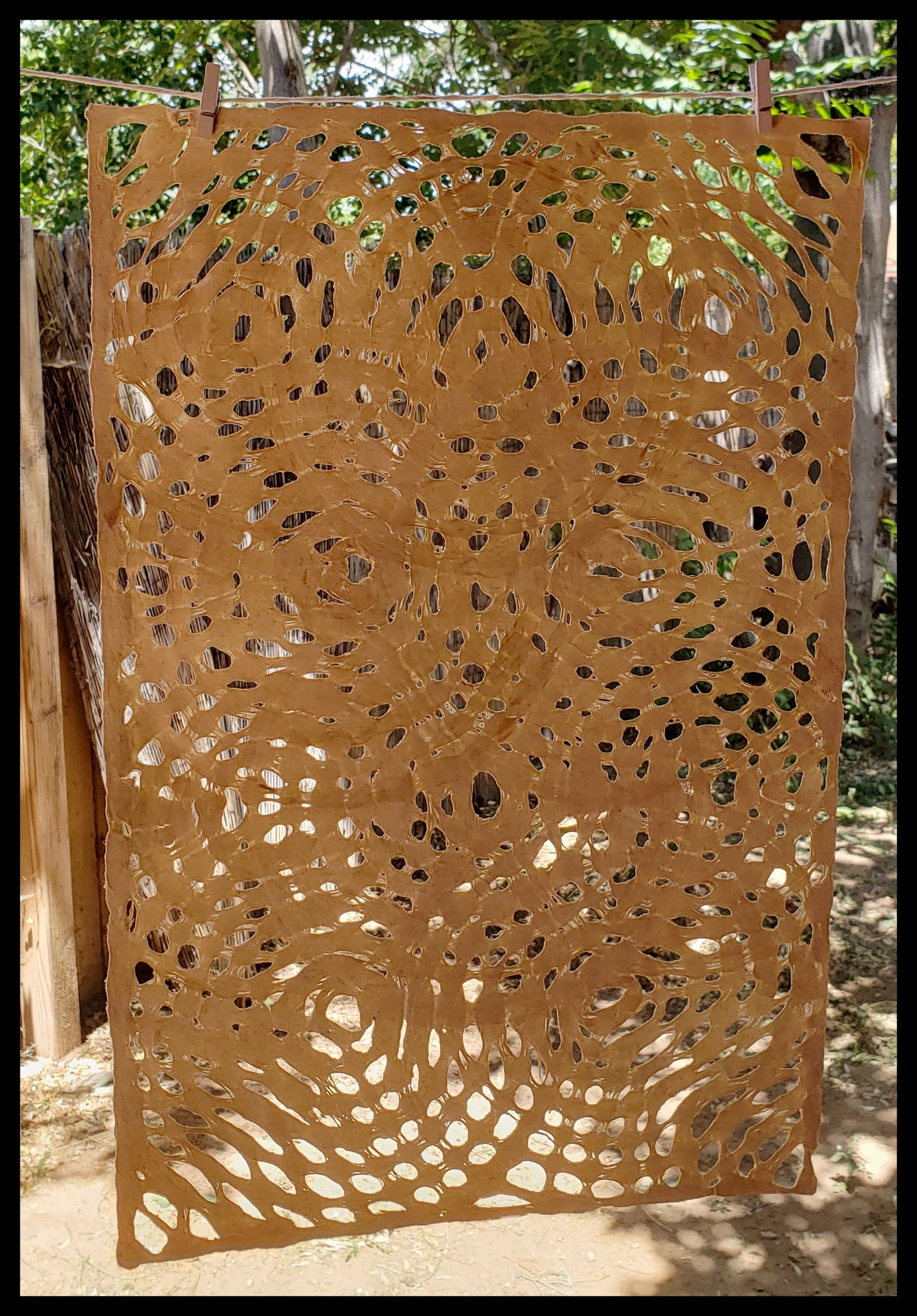 Handmade paper made in Mexico from fig trees cut out circle pattern patterns will vary natural tan ADA The Gilded Page Santa Fe
