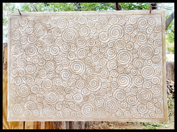 Textured white handmade embossed mulberry paper deckled edges swirls & circles patterns will vary ADA The Gilded Page Santa Fe