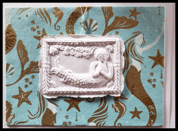 "Mermaid paper cast with blue & gold mermaid background handcrafted card blank inside removable ornament 4.5"" x 6"" with envelope ADA The Gilded Page Santa Fe"