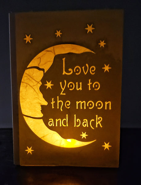 Handcrafted Luminaria or Farolito moon and stars with Love you to the moon and back in script 5x7 ADA The Gilded Page Santa Fe New Mexico