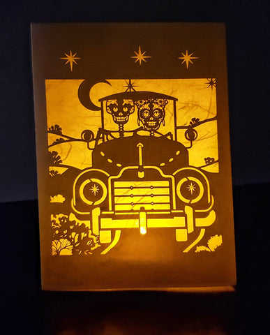 Handcrafted Luminaria or Farolito Skeletons driving in a car at night 5x7 ADA The Gilded Page Santa Fe New Mexico