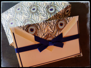 "Italian Boxed Peacock Feather Cards 10 cards & 10 envelopes   Printed peacock feather pattern with gold accents inside envelope   3.5"" x 5.5"" with envelope   Folded card   Navy  border   Off white cards & envelopes  ADA The Gilded Page Santa Fe"