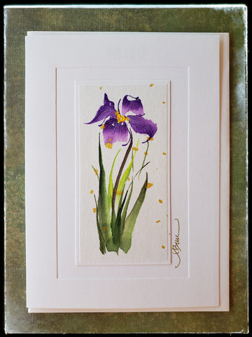 "February Iris Flower Hand Painted Card Chinese refer to the iris as the ""Purple Butterfly"" for its soft fluttering petals flapping gently in the breeze. The petals symbolize faith, hope, valor and wisdom.   Gold accents  Individually hand-painted on rice paper  Hand-painted images will vary  BLANK INSIDE  5.5"" x 7.5"" with envelope ADA The Gilded Page Santa Fe"