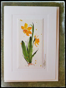 "March Daffodil Flower Hand Painted Card Light gold petals with sweet fragrance. A sign of winter's end and arrival of spring. It symbolizes good fortune, prosperity and new beginnings.  Gold accents  Individually hand-painted on rice paper  Hand-painted images will vary  BLANK INSIDE  5.5"" x 7.5"" with envelope ADA The Gilded Page Santa Fe"