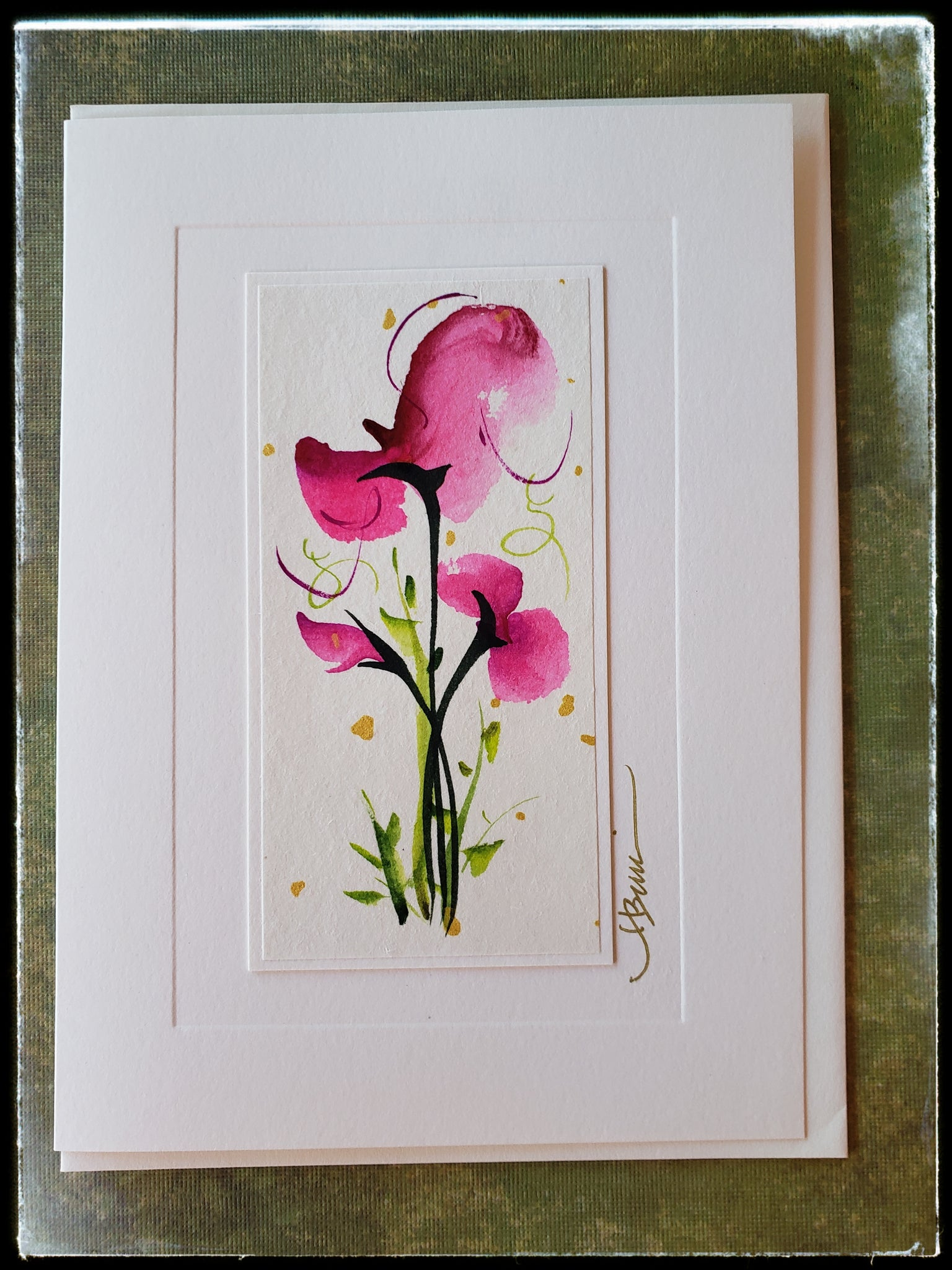 "April Sweet Pea Flower Hand Painted Card In constant bloom, it symbolizes lasting pleasure. Its delicate beauty is emblem of shyness and innocence.  Gold accents  Individually hand-painted on rice paper  Hand-painted images will vary  BLANK INSIDE  5.5"" x 7.5"" with envelope ADA The Gilded Page Santa Fe"