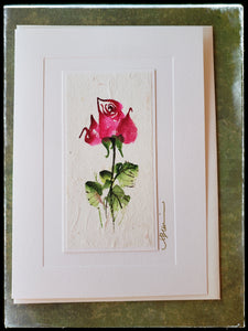 "June Rose Flower Hand Painted Card For centuries, the rose has been a symbol of love, beauty and passion.  Gold accents  Individually hand-painted on rice paper  Hand-painted images will vary  BLANK INSIDE  5.5"" x 7.5"" with envelope ADA The Gilded Page Santa Fe"