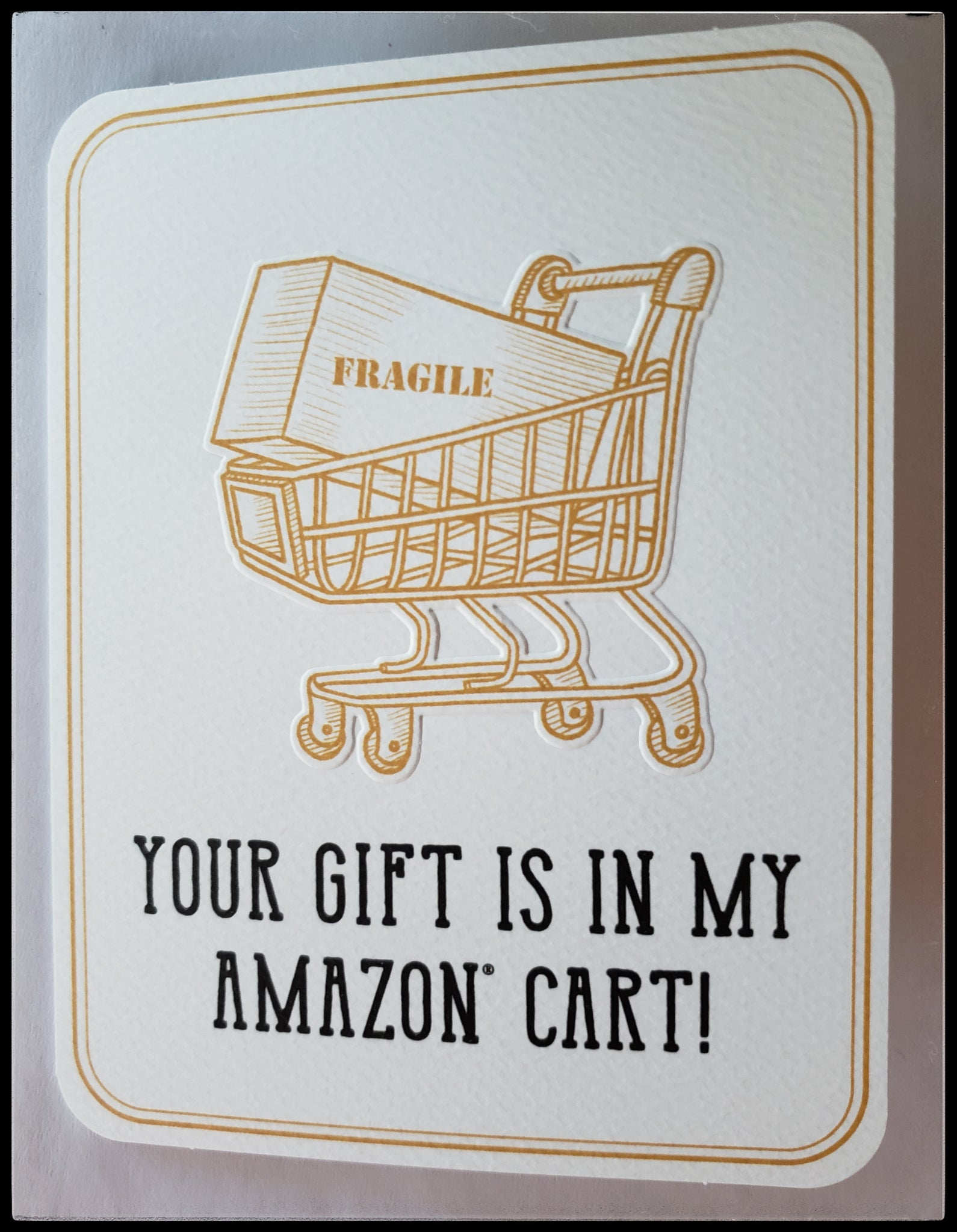 "Your gift is in my amazon cart!   Message inside: ""I didn't check out, but the effort was made""   Decorative sticker seal included   Decorative envelope liner   Image shopping cart with box in it that says fragile ADA the gilded page Santa Fe"
