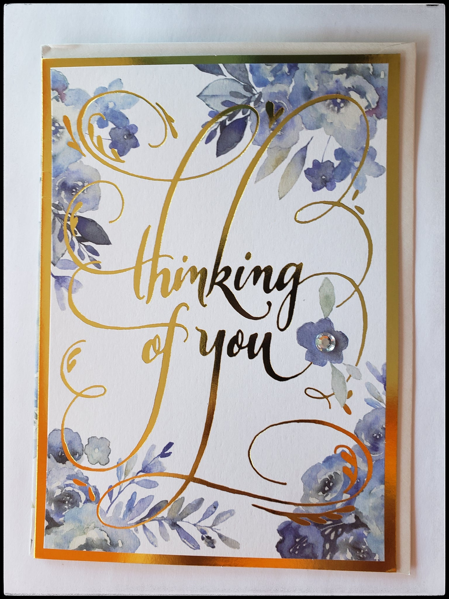 "Thinking Of You  Inside message: You are so special to me, and you are always in my thoughts""   Full color embellished interior   Blue floral with gold accents   Decorative envelope liner   Extra postage may be required   5.5"" x 7.5"" with envelope ADA Santa Fe The Gilded Page"