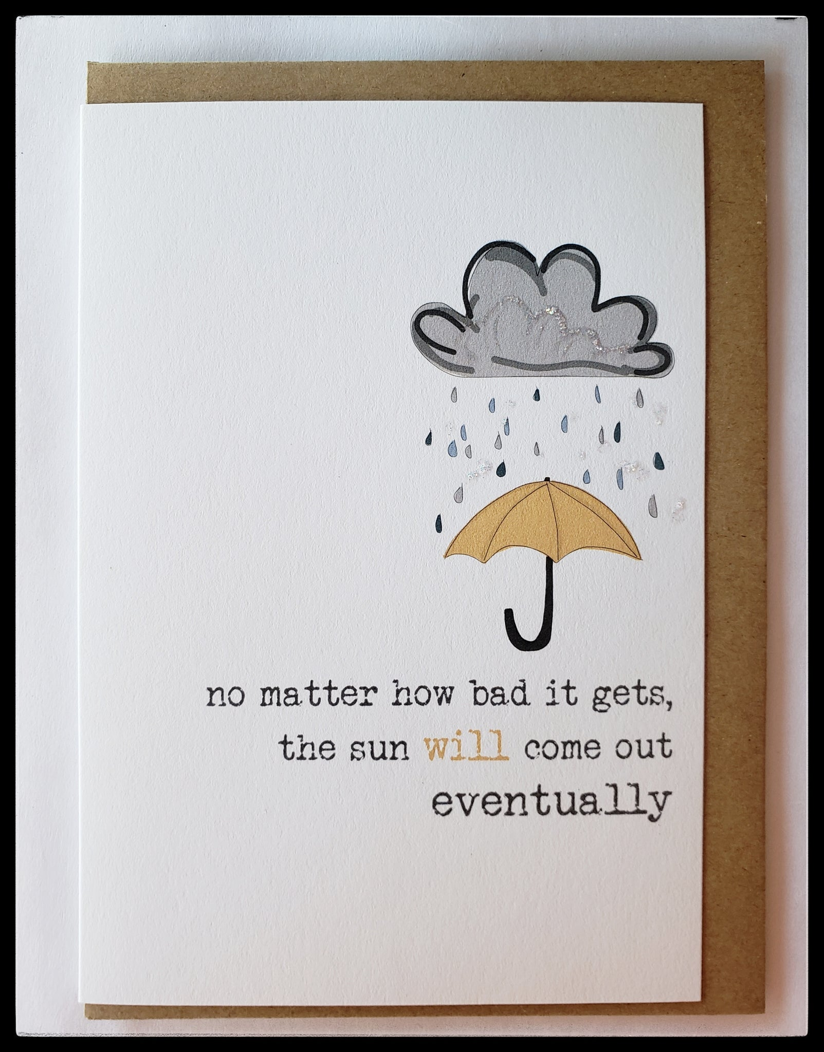 "Sympathy card 5"" x 6.5"" with envelope blank inside front image yellow umbrella under cloud and rain message on front no matter how bad it gets the sun will come out eventually ADA the gilded page Santa Fe"