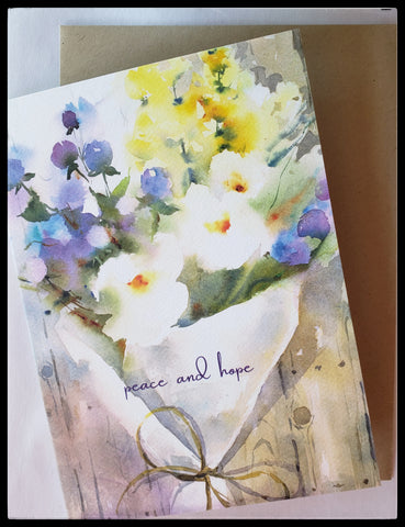 "Peace & Hope   Inside Message: ""All thoughts are with you""  Printed in the USA using clean manufacturing   5"" x 6.5"" with envelope   Floral watercolor design  ADA The Gilded Page Santa Fe"