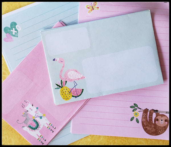 children's stationary set animals  8 letter sheets  1 notebook  1 mechanical pencil  1 four click pen     4 envelopes   1 sticker sheet with multi stickers  4 postcards   1 traveling case to keep everything together! ADA The Gilded Page Santa Fe