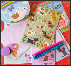 Children dogs & cats stationary set 8 letter sheets  1 notebook  1 mechanical pencil  1 four click pen  1 eraser   4 envelopes   1 sticker sheet with multi stickers  4 postcards   1 traveling case to keep everything together! ADA The Gilded Page Santa Fe