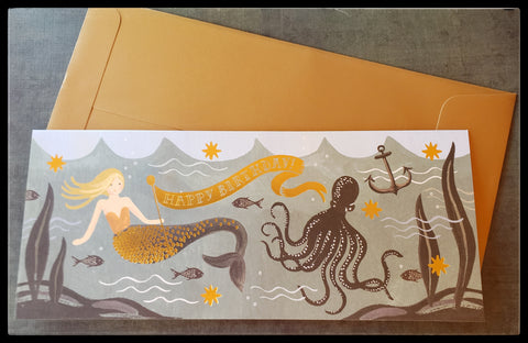 "Abstract mermaid in the ocean with an octopus , fish and an anchor BLANK INSIDE   4.5"" x 9.5"" with envelope  Good accents   Works well as a ""money card"" ADA The Gilded Page Santa Fe New Mexico"