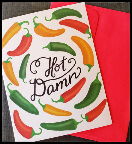 "Message on front Hot Damn image on front yellow green and red peppers BLANK INSIDE   Purchase of this card helps send girls around the world to school to be educated & empowered.   Red envelope   4.5"" x 6"" with envelope ADA The Gilded Page Santa Fe New Mexico"