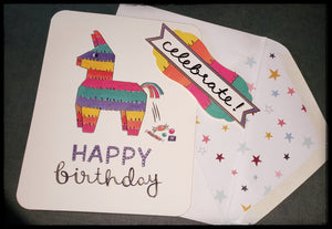 "pinata pooping candy BLANK INSIDE   Matching envelope   Decorative sticker seal that says ""Celebrate""   Gold accents  4.5"" x 6"" with envelope ADA The Gilded Page Santa Fe New Mexico"