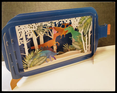"Dino birthday party   Pop up, die-cut, free standing   5"" x 9.5"" with envelope   BLANK INSIDE   Area on back to write message  ADA The Gilded Page Santa Fe New Mexico"