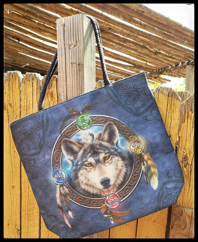 "Wolf head in a dream catcher Durable market bag  Burlap materiel with faux suede inside   Durable rope straps   Width 17""  Height 16.5""  Bottom width open 5""  Straps 10.5"" ADA The Gilded Page Santa Fe New Mexico"