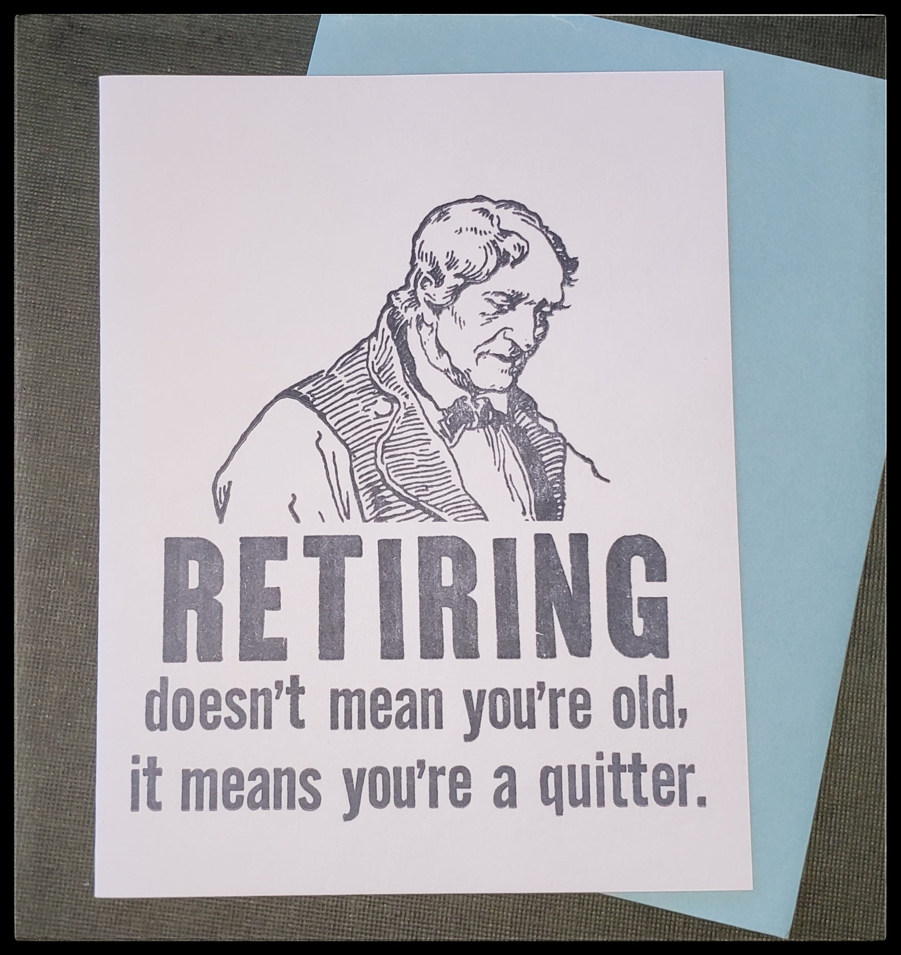 "Retiring doesn't mean you're old, it means you're a quitter.   BLANK INSIDE   Blue envelope   Letterpress   4.5"" x 6"" with envelope  ADA The Gilded Page Santa Fe New Mexico"