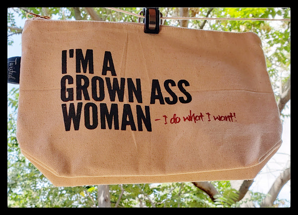 "I'm A Grown Ass Woman- I do what i want!  Canvas clutch bag  Zipper closure  Washable interior  11"" Length 7.5"" top to bottom 3"" open bottom  ADA The Gilded Page Santa Fe New Mexico"