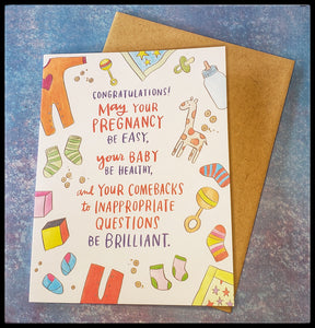"Congratulations! May your pregnancy be easy, your baby be healthy, and your comebacks to inappropriate questions be brilliant.   BLANK INSIDE   Kraft envelope   4.5"" x 6"" with envelope  ADA The Gilded Page Santa Fe New Mexico"