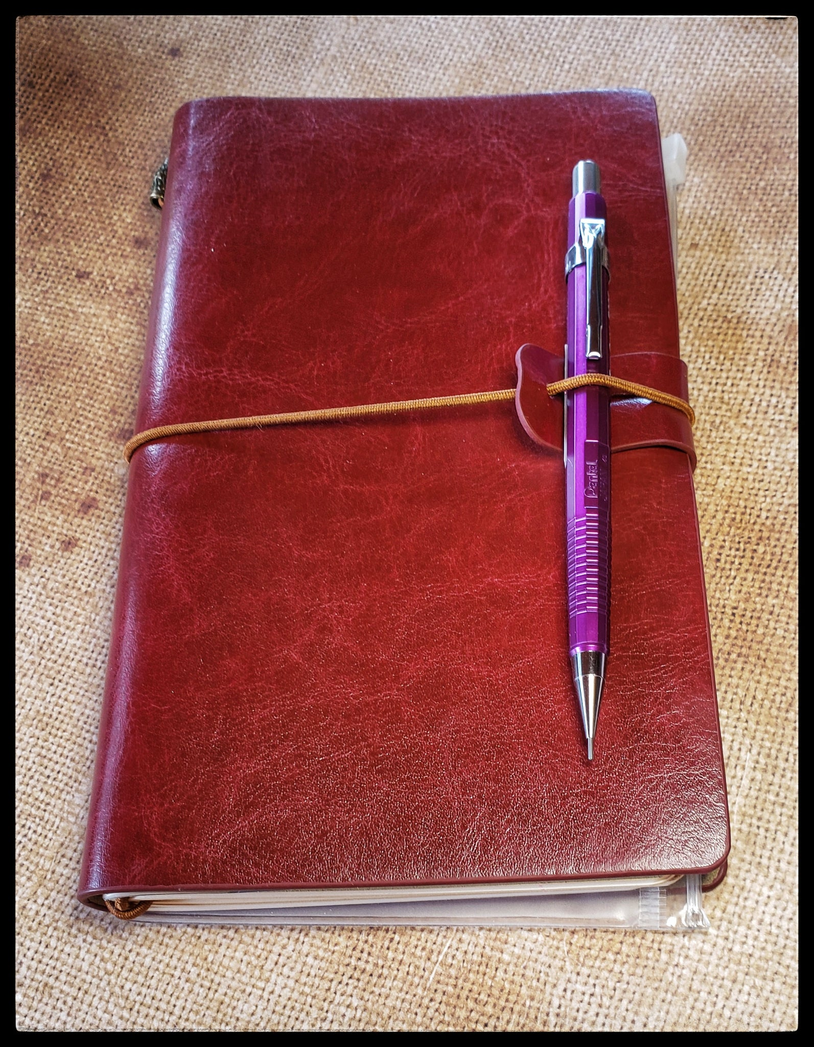 "Burgundy Voyager Notebook  Lined paper. Dot Grid paper. Blank paper   Zippered storage pocket   Adaptable. Easy to swap inserts  Protective faux leather cover   Ideal for bullet journaling, sketching, note-taking,lettering and more  Includes three 60 page inserts   Spine bands secure notebook contents   Elastic band closure   4.5"" x 8""  Mechanical  pencil not included. See our Writing selection to purchase separately ADA The Gilded Page Santa Fe New Mexico"