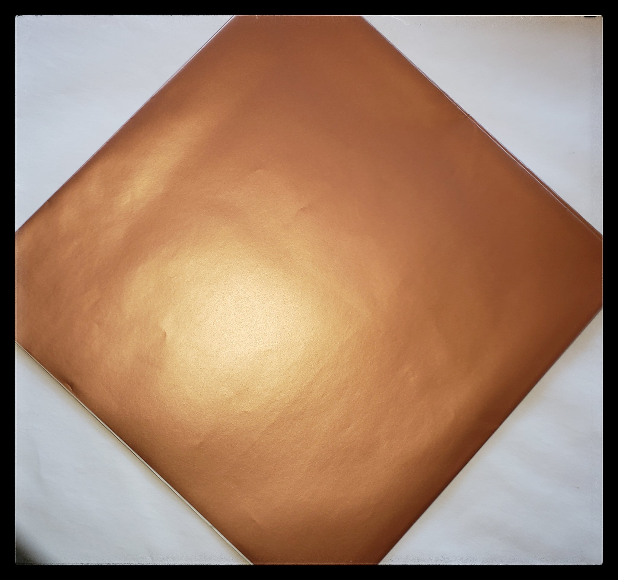 "Metallic bronze   2 Sheets in a pack   20"" x 30"" (51cm x 76cm)    Arrives folded in package 10"" x 10""   Gift wrap contains 100% recycled fiber ADA The Gilded Page Santa Fe New Mexico"