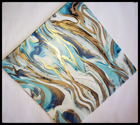 "Blue & Gold Marble   2 Sheets in a pack   20"" x 30"" (51cm x 76cm)   Arrives folded in package 10"" x 10""   Gift wrap contains 100% recycled fiber   ADA The Gilded Page Santa Fe New Mexico"