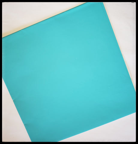 "Sky Blue   2 Sheets in a pack   20"" x 30"" (51cm x 76cm)   Arrives folded in package 10"" x 10""   Gift wrap contains 100% recycled fiber ADA The Gilded Page Santa Fe New Meexcio"