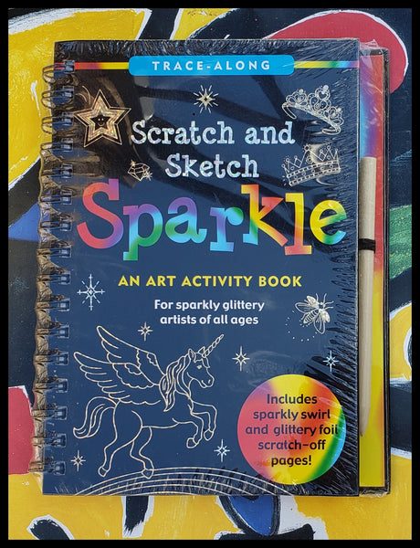 "ADA An art activity book for sparkly glittery artists of all ages  Includes sparkly swirl and glittery foil scratch off pages   Scratch book contains   10 black coated gold and silver sparkles pages   10 black coated colorful sparkle pages   20 illustrations to trace and complete   20 extra pages for sketching and doodling   Wooden stylus for drawing   6.5"" x 8.5""   Spiral Bond     Activity Book, The Gilded Page Santa Fe, New Mexico Online"