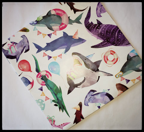 "Shark Party   2 Sheets in a pack   20"" x 30"" (51cm x 76cm)   Arrives folded in package 10"" x 10""   Gift wrap contains 100% recycled fiber ADA The Gilded Page Santa Fe New Mexico"