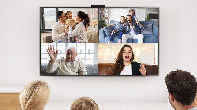 family enjoying a video call on their TV with zoom