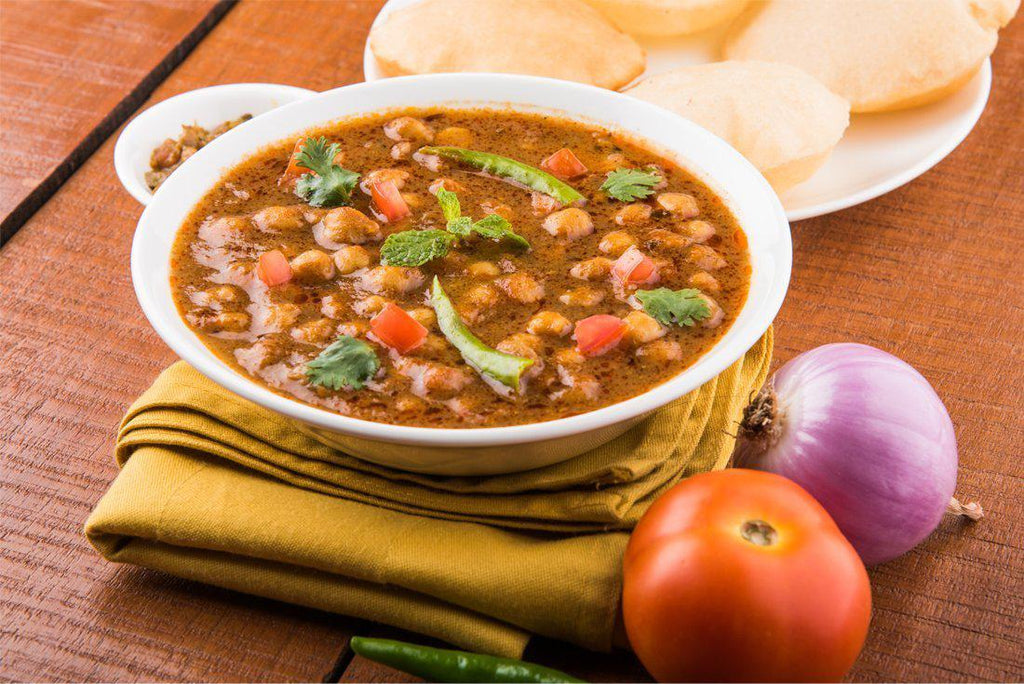 "Chole Masala - ""Tempting chick peas curry prepared in tomatoes, onions and selected Indian spices"" - Just2Eat"