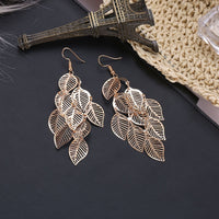 Classic Layered Leaves Bohemian Designed Earrings available in Gold and Silver. TER 1009