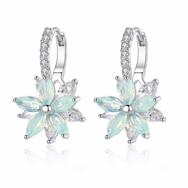 Enchanting Zircon Flower Shaped Stud Earrings available in 4 colours.TER 1006