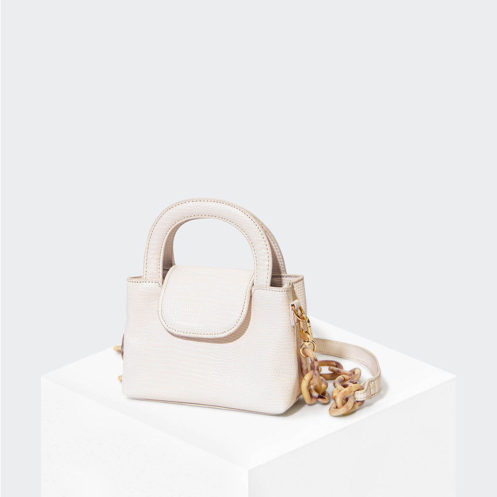 "HOUSE OF WANT ""Snack"" Mini Top Handle Crossbody White Lizard - front"