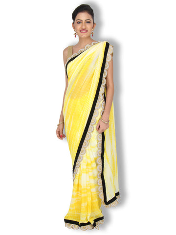 Bright yellow tie and dye saree with black velvet and curved pearl border