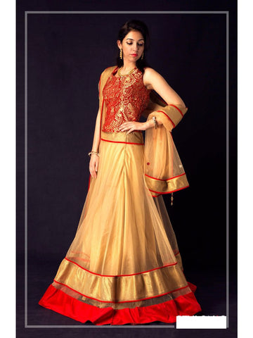 Gold net lehenga with red jamawar corset and golden shimmer net dupatta