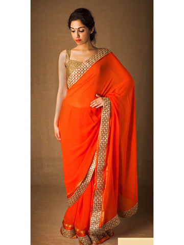 Orange gold georgette saree with golden cutwork and stone border
