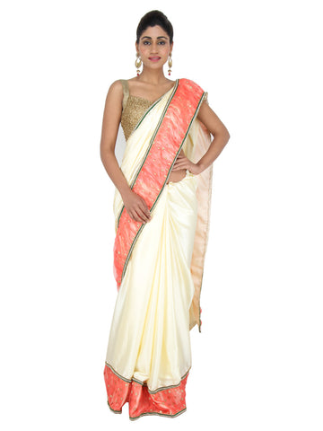 Pearl white Satin saree with peach net frill border and zari buttas