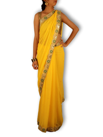 Yellow georgette saree with Golden/green mirror work curve border