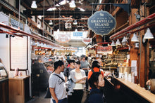 Granville Island Market inside crowded with people