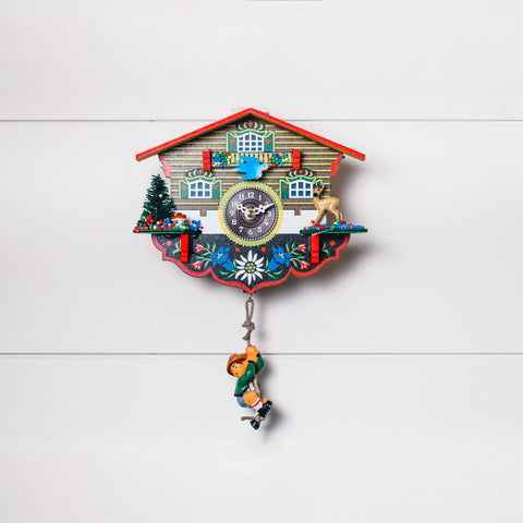 Miniature cuckoo style clock with hanging German alpinist on a rope below
