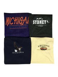 An image of four different vintage t-shirts with destination names