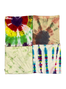 An image of four different vintage tie-dye shirts