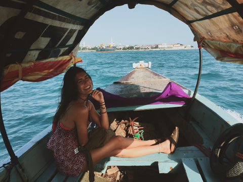 owner of ethical clothing brand pushaoo in boat in zanzibar