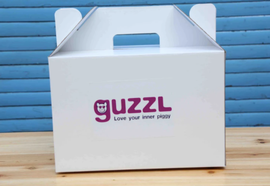 An environmentally friendly hamper box for all your goodies - Guzzl