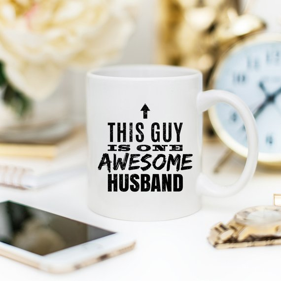 11oz Coffee Mug - This Guy Is One Awesome Husband - Cream and Sugar Coffee House & Brewing Co.