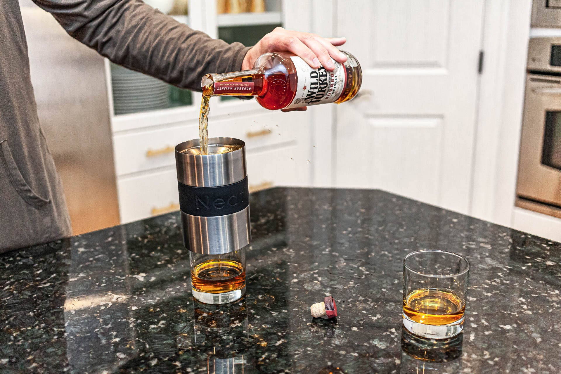 pouring whiskey through the chiller